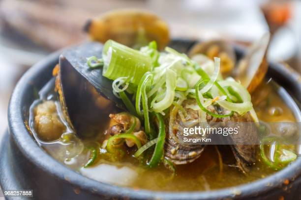 traditional korean seafood stew - jeju stock photos and pictures