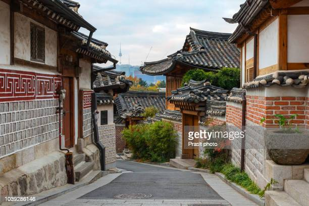 traditional korean style architecture at bukchon hanok village with n seoul tower in background in seoul, south korea. - south korea stock pictures, royalty-free photos & images
