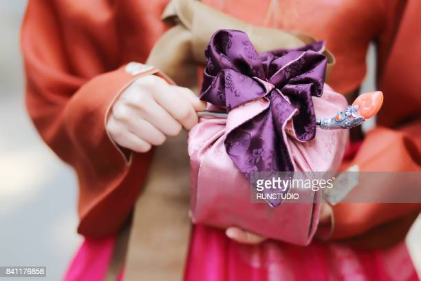 traditional korean woman with a gift - korean culture stock pictures, royalty-free photos & images