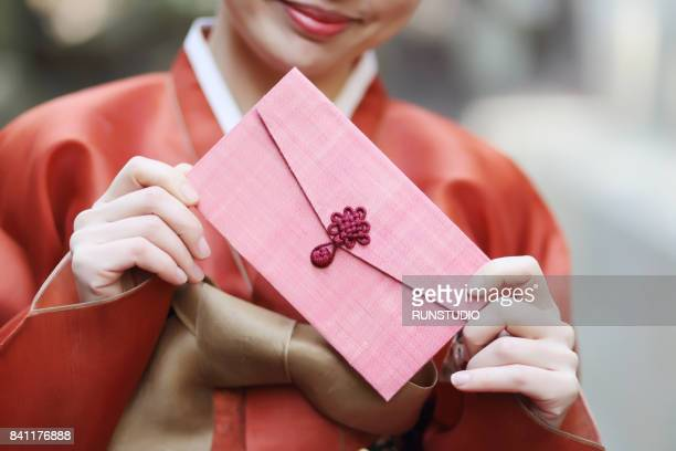 traditional Korean woman with a gift