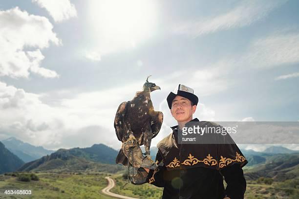 Traditional Kyrgyz Hunter Holding Eagle