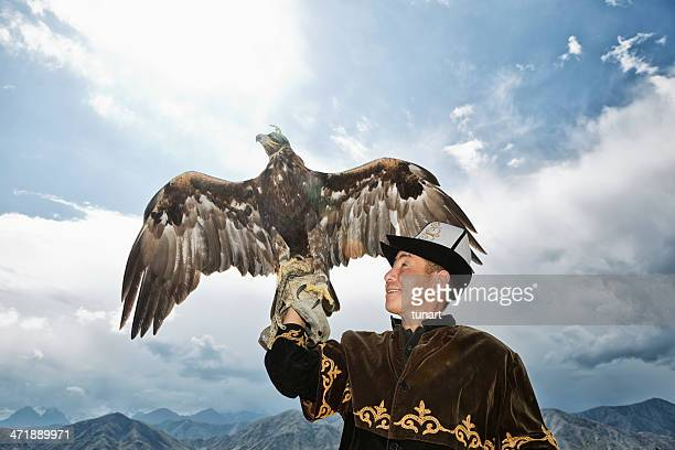 Traditional Kyrgyz Hunter Holding Eagle