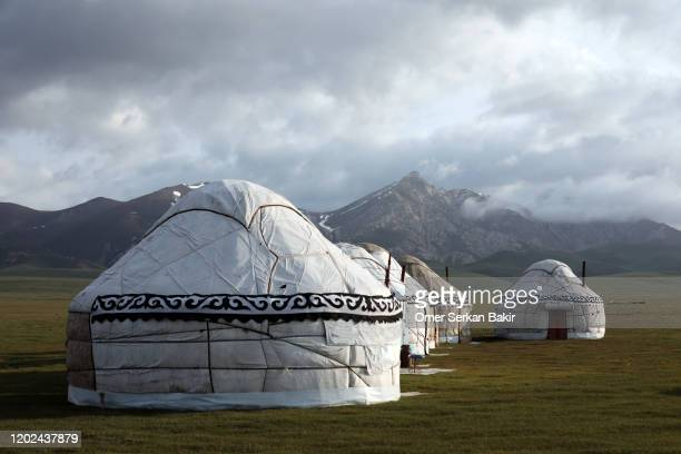 traditional kyrgyz tents yurt. song kol lake, kyrgyzstan. - kyrgyzstan stock pictures, royalty-free photos & images