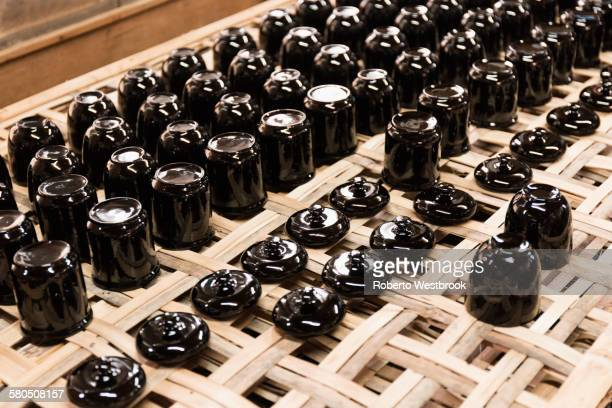 Traditional lacquerware drying on rack
