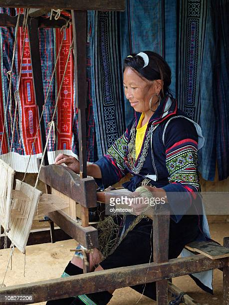 Traditional Lady Operating Weaving Loom