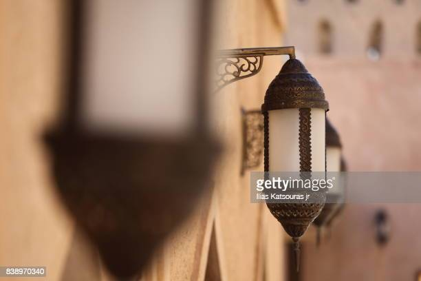 traditional lanterns at sandstone nizwa castle in oman - arabian peninsula stock pictures, royalty-free photos & images