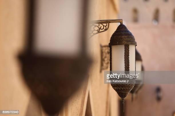 Traditional lanterns at sandstone Nizwa Castle in Oman