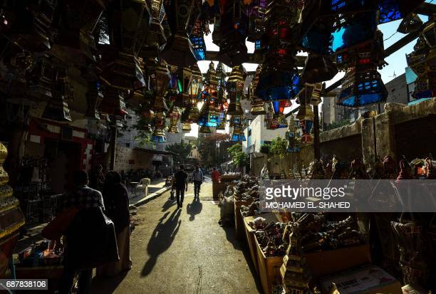 Traditional lanterns known in Arabic as 'Fanous' sold during Ramadan are seen for sale in Cairo's Saida Zeinab district on May 24 ahead of the start...