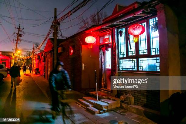Traditional lanterns on the occasion of the celebration of the Chinese New Year Image d in the hutongs historic neighborhoods of alleyways in the...