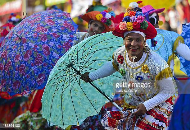 Traditional 'Las Farotas' dancers take part in the second day of carnival parade in Barranquilla Colombia on February 10 2013 Barranquilla's Carnival...