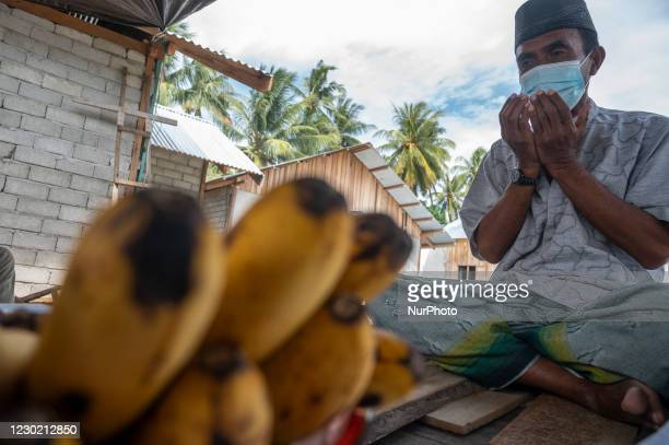Traditional leader sits and prays on a boat during a new boat salvation ritual in Pantoloan Boya Village, Palu City, Central Sulawesi Province,...