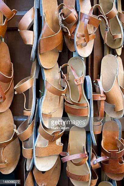 traditional leather sandals for sale, rhodes town, greece - sandaal stockfoto's en -beelden
