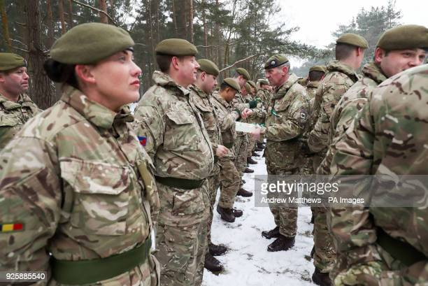 Traditional leeks are handed out to members of 1st Battalion Welsh Guards during the combined St David's Day celebration and predeployment service at...