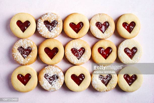 traditional linzer cookie with strawberry jam - valentine's day holiday stock pictures, royalty-free photos & images