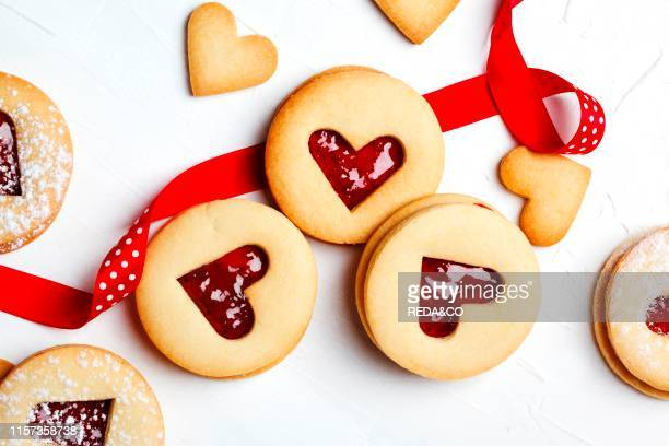 Traditional Linzer cookie with strawberry jam top view Valentine's day concept