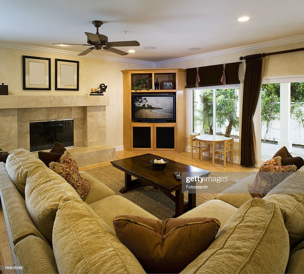 Living Room With Fireplace And Sliding Doors: Traditional Living Room With Couch Fireplace Entertainment
