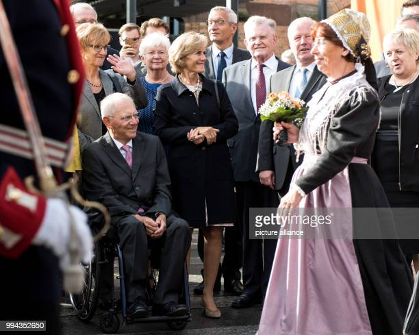 Traditional local costume groups greet the German finance minister Wolfgang Schäuble and his wife Frau Ingeborg at a reception marking his 75th...