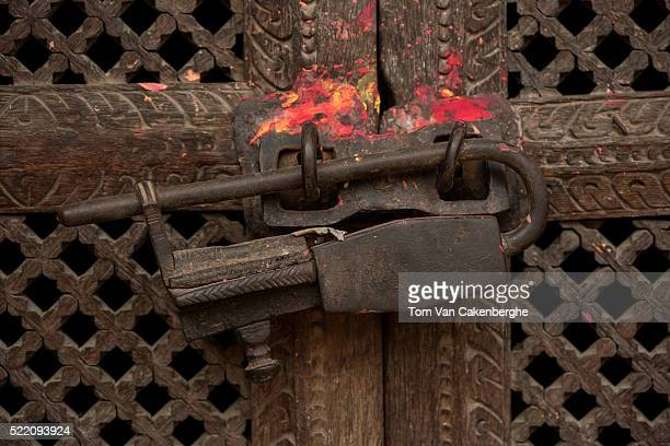 A traditional lock is seen on a temple door in Patan on March 21 2016 in Kathmandu Nepal Theft of ornaments and religious idols is rife in Nepal...