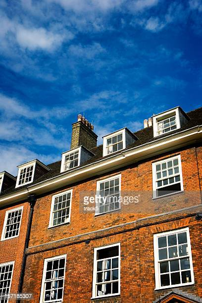 Traditional London red brick Georgian period building with blue skies