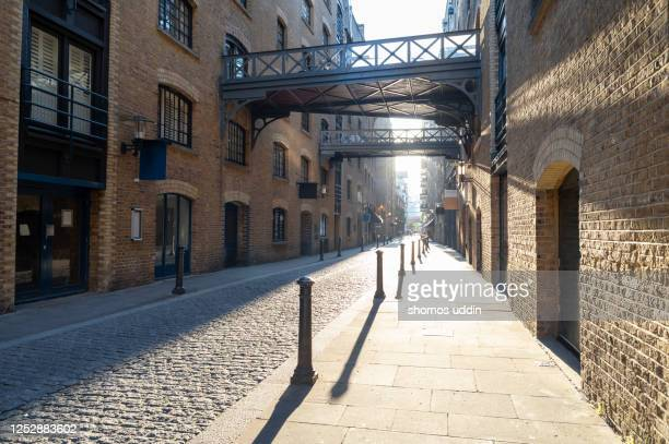 traditional london street - cobblestone stock pictures, royalty-free photos & images