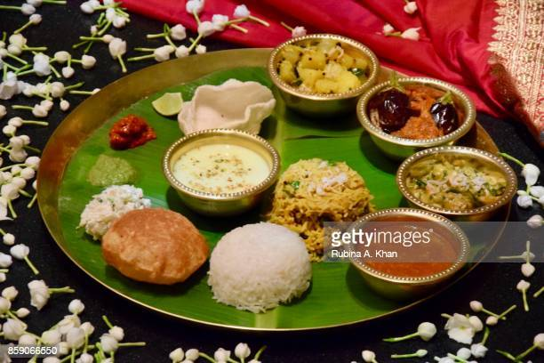A traditional Maharashtrian vegetarian thali where each food item is placed anticlockwise on it starting from the left to the right prepared by Chef...