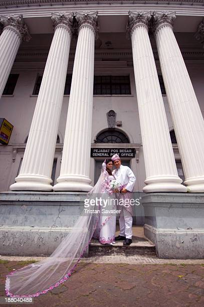 Traditional Malay Wedding in Kuching . The couple was in fact posing for their photographer, who was shooting their wedding photos. They take the...