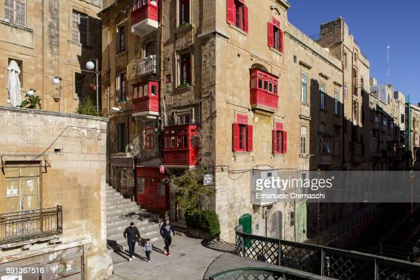 A traditional Maltese building with enclosed balconies on December 8 2017 in Valletta Malta Valletta a fortified town that dates back to the 16th...