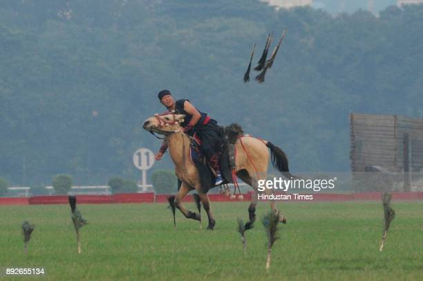 Traditional Manipuri Horse trick Arambai Langba exhibited during to mark the 46th anniversary of Vijay Diwas at RCTC ground on December 14 2017 in...