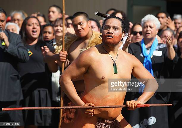 A traditional Maori Warrior lays down a challenge during the Tonga IRB Rugby World Cup 2011 official team welcome ceremony at Papakura Marae on...