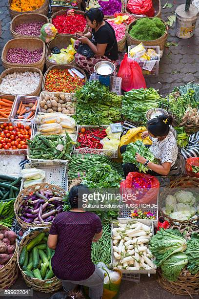 Traditional market sellers with baskets of vegetables, elevated view, Ubud, Bali, Indonesia