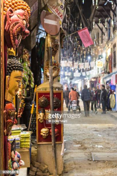 Traditional masks displayed in front of a souvenir shop in the streets of Thamel in Kathmandu