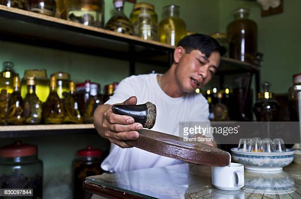 A traditional medicine specialist pours the grindings of Rhino horn mixed with water into a cup for drinking in Saigon Vietnam on October 4 2011 He...