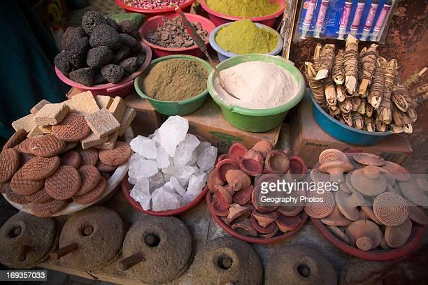 Traditional medicines and cosmetics on medina market stall Marrakech Morocco