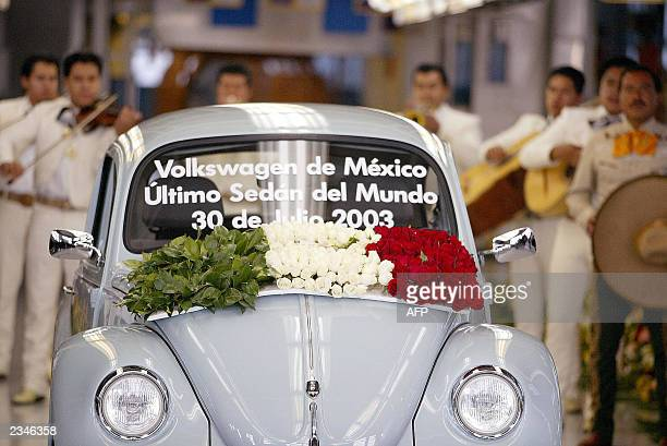 Traditional Mexican Mariachi musicians play as the very last VW Beetle rolls off the production line at VW's Puebla plant 30 July 2003 Volkswagen is...