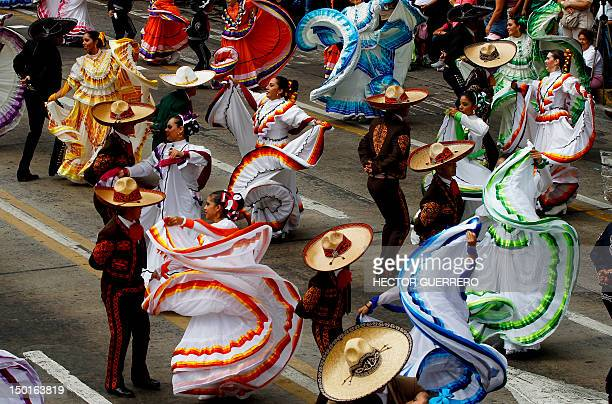 Traditional Mexican music dancers perform during a festival in Guadalajara, Mexico on August 11, 2012. AFP PHOTO / Hector Guerrero