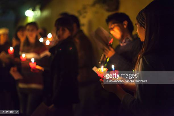Traditional Mexican posada taking place. Posada is a representation of the Virgin Mary looking for shelter so Baby Jesus can be born. Posadas take...