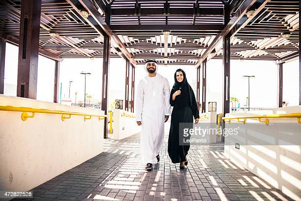 Traditional middle eastern couple walking outdoor in Dubai