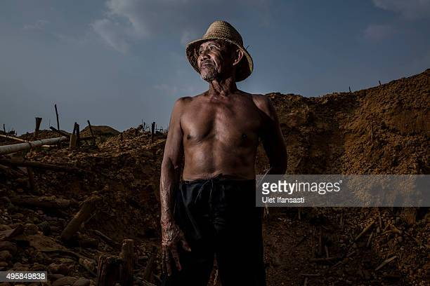 A traditional miner Abdul Rahman stands for photograph as they search for diamond in Cempaka village at Martapura also known as the City of Diamond...