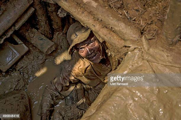 Traditional miner Jam'an , digs inside a hole searching for diamonds in Cempaka village at Martapura, also known as the City of Diamond, on November...