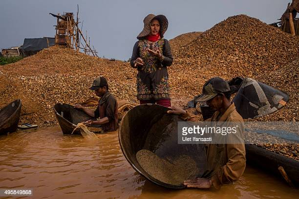Traditional miners wash mud in conical bowls known as 'Linggang' as they search for diamonds in Cempaka village at Martapura also known as the City...