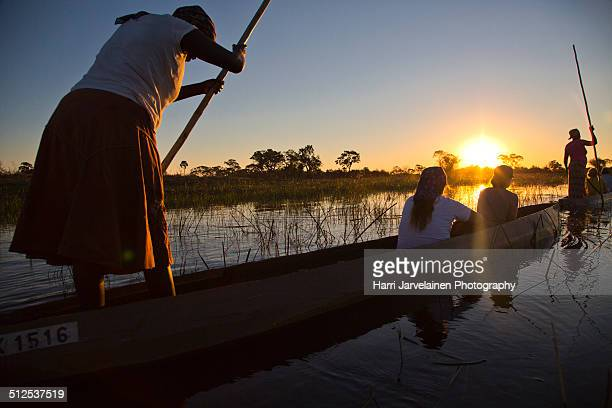 traditional mokoros (dug-out canoes) in okavango - okavango delta stock pictures, royalty-free photos & images