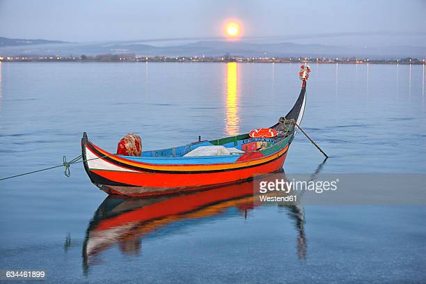 Traditional moliceiro fishing boat at sunset
