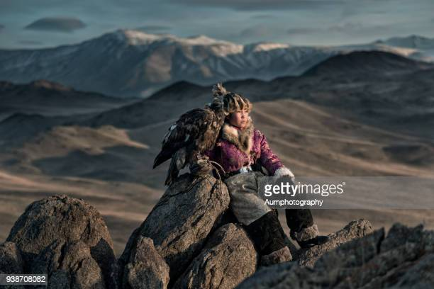 Traditional Mongolian Young woman Eagle Hunters