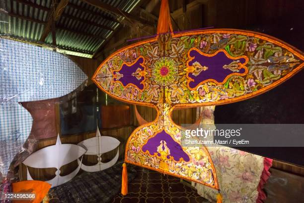 traditional moon kite or locally known as wau bulan on display in kelantan, malaysia. - shaifulzamri stock pictures, royalty-free photos & images