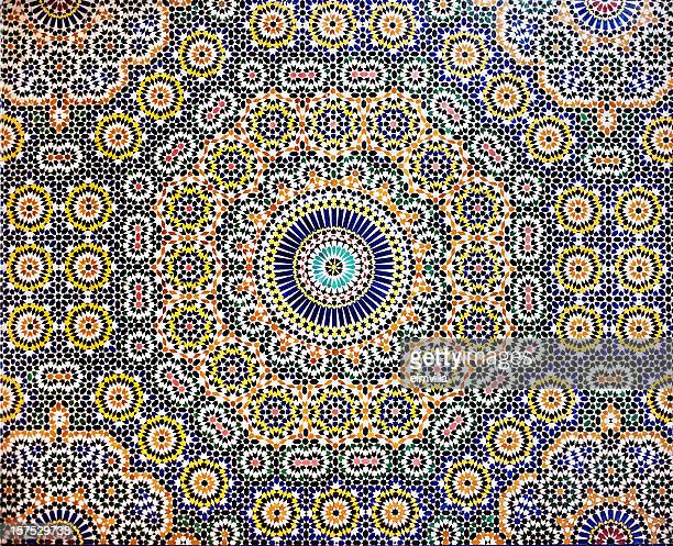 traditional moroccan mosaic pattern tiled wall - moroccan culture stock photos and pictures