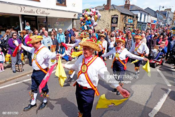 traditional Morris dancers in the streets of Camborne Cornwall England UK