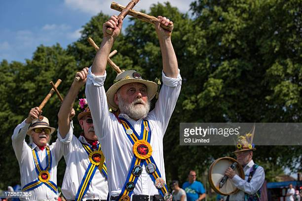 CONTENT] Traditional Morris Dancers performing on a hot summer day at the annual carnival in Lutterworth Leicestershire