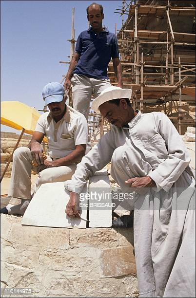 Traditional mortar cut stone Egyptian workers keep busy at the site nursing the monument with traditionnal not to say ancestral techniques in Cairo...