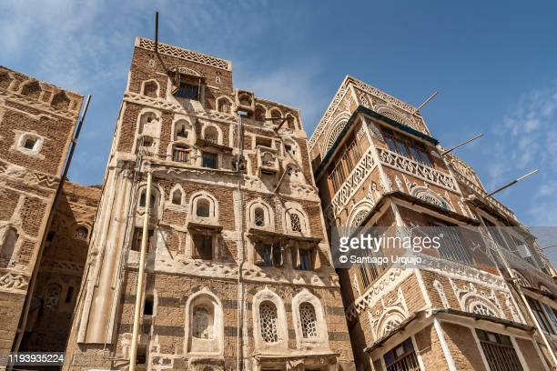 traditional mud-brick buildings in old town of sanaa - sanaa stock pictures, royalty-free photos & images