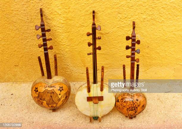 traditional musical instrument - senegal stock pictures, royalty-free photos & images